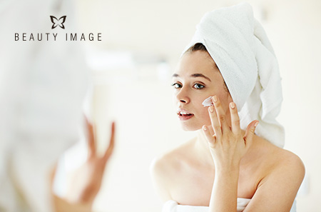 Woman getting her skincare routine before hard body waxes