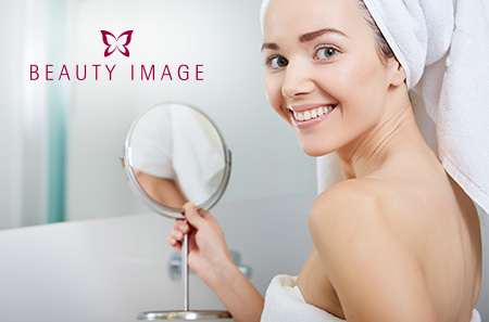 Woman Smiling with Towel on Head