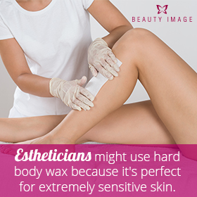 Esthetician using hard body wax in pregnant woman