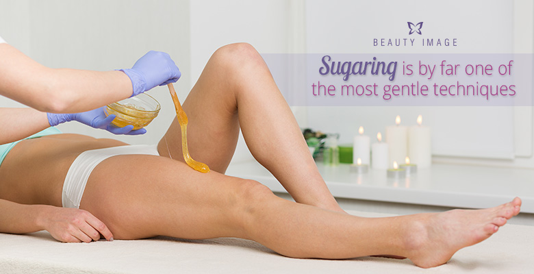 Woman getting a sugaring hair removal product