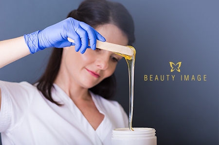 Young Woman Waxing with Hair Removal Products