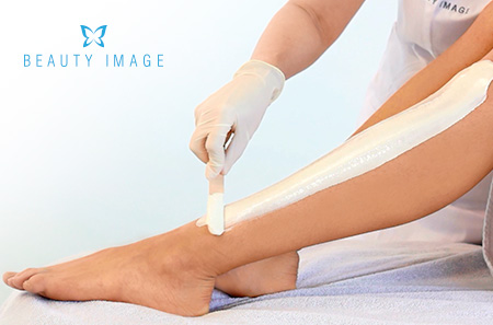 Hair Removal Products Applying on a Leg