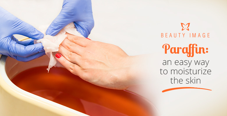 Woman's Hand Applaying Paraffin Wax Treatment