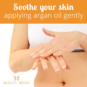 Argan Oil Benefits for Skin Massaging Hands With Argan Oil