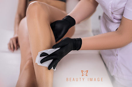 Leg Waxing Esthetician Prepping Legs for Waxing