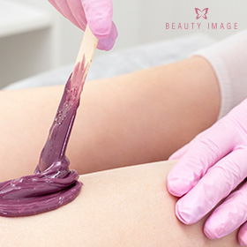 Esthetician Applying Hard Wax Beads