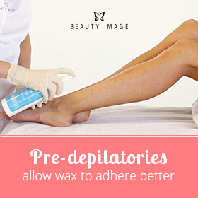 Esthetician Applying a Pre-depilatory Lotion on Legs