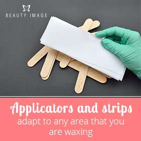 Beautician Hand with Waxing Accessories
