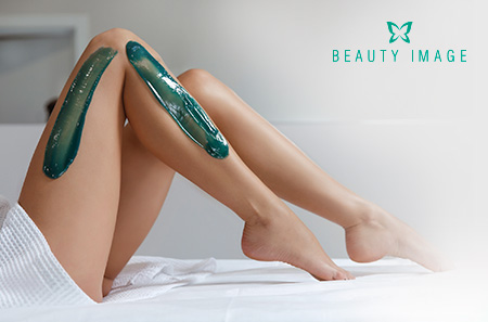 Woman Legs with Green Soft Wax